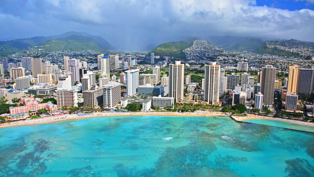 Above: Waikiki beach photographed from a Genesis Aviation Helicopter tour. Much of Hawaii's economy is reliant on tourism and hospitality.Image Credit: Edmund Garman/Flickr